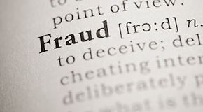 Close up of the word fraud on the page of a dictionary