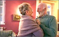 Elderly couple dancing.