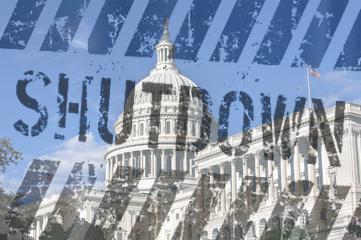 The letters SHUTDOWN over top of an image of the Capital Building.