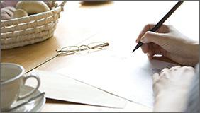 Elder signing paper