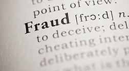 The word Fraud in bold text on a page in a dictionary.