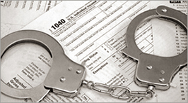 Tax return with handcuffs on top