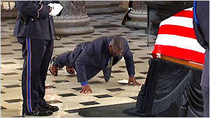 Trainer at Ginsburg casket doing pushups