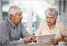 Elder couple on laptop