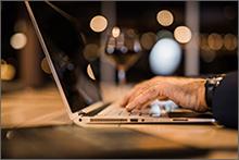 Elder hands on a laptop